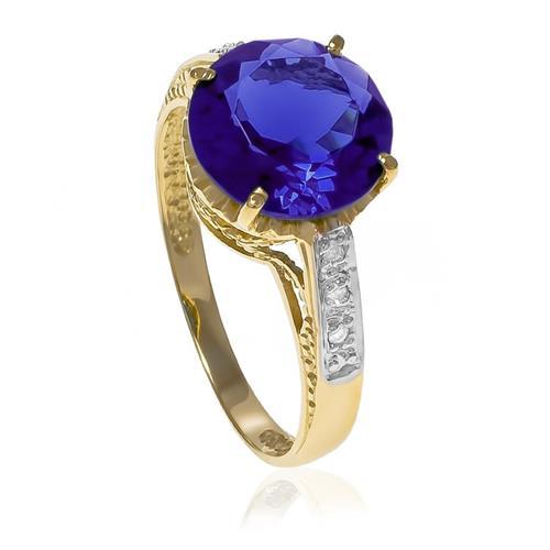 Anel com 6 Diamantes e Cristal de Tanzanita Central¸ em Ouro Amarelo