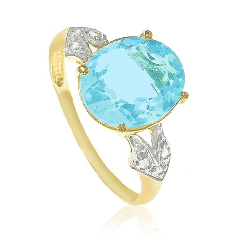 Anel com 6 Diamantes e Topázio azul Sky Blue oval¸ em Ouro Amarelo