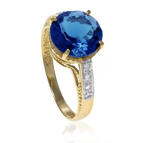 Anel com 6 Diamantes e Topázio Azul Central¸ em Ouro Amarelo