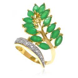 Anel Trabalhado com 7 Diamantes e 13 Esmeraldas Navetes¸ em Ouro Amarelo