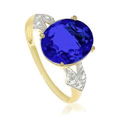 Anel com 6 Diamantes e Cristal de Tanzanita Oval, em Ouro Amarelo