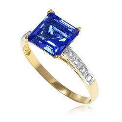 Anel Trabalhado com 8 Diamantes e Topázio London Blue¸ em Ouro Amarelo
