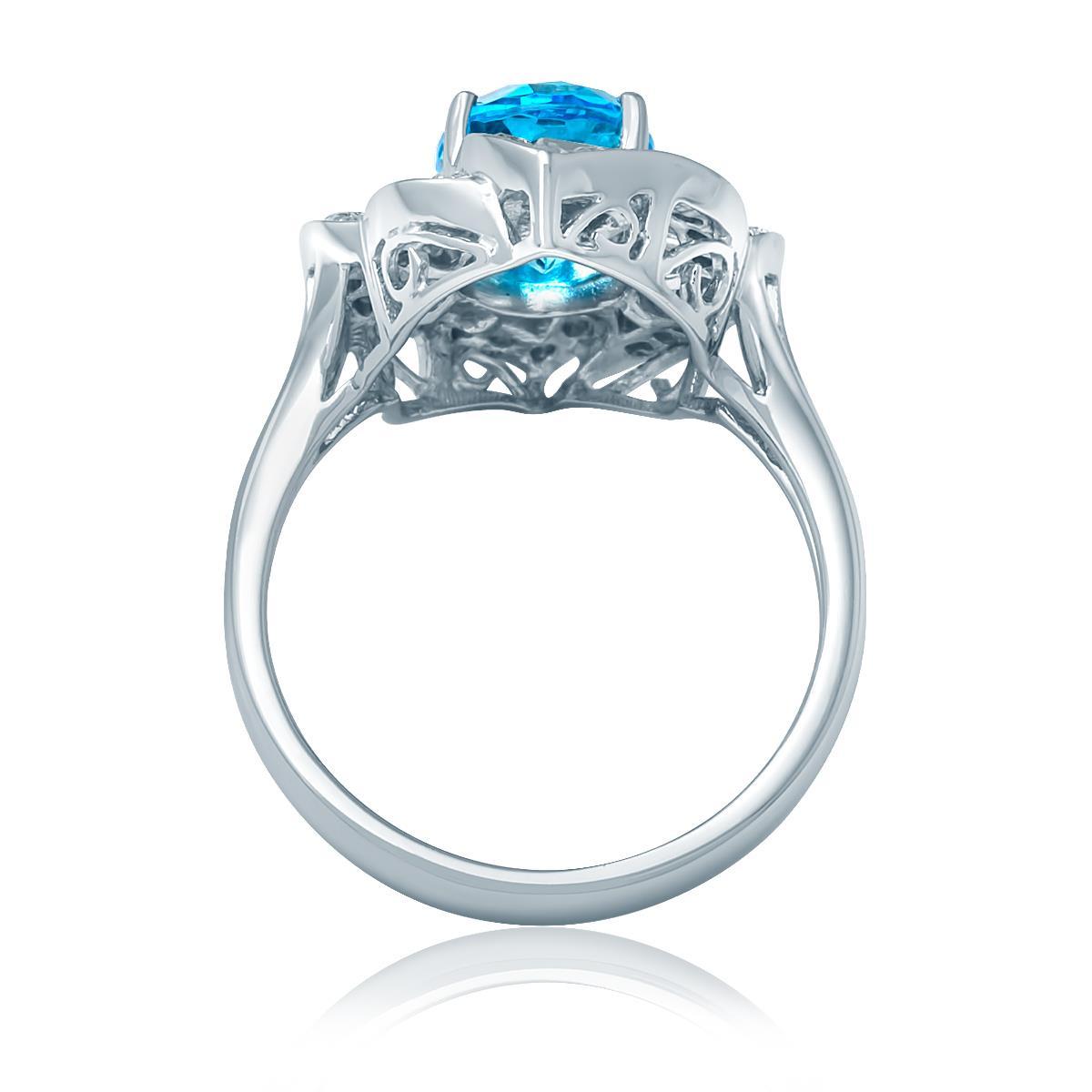 Anel com Topázio Azul central de 3,6 Cts e Diamantes, em Ouro Branco eb5a67aff0